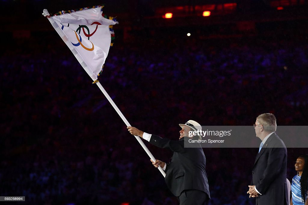 Mayor of Rio de Janeiro Eduardo Paes and IOC President Thomas Bach take part in the Flag Handover Ceremony during the Closing Ceremony on Day 16 of...