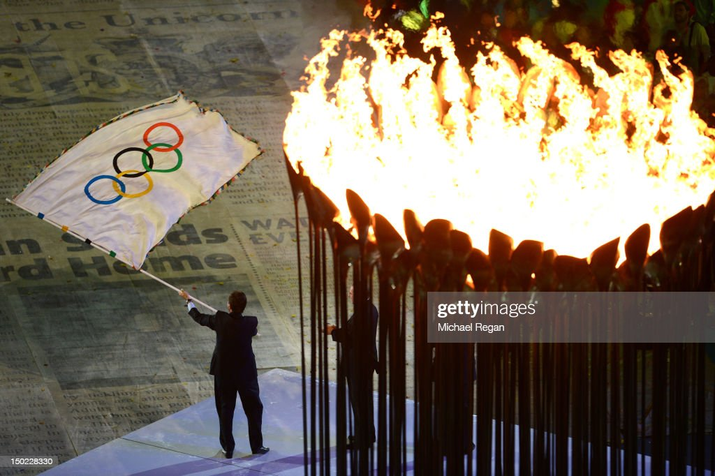 Mayor of Rio de Janeiro Eduardo Paes flies the Olympic flag during the Closing Ceremony on Day 16 of the London 2012 Olympic Games at Olympic Stadium on August 12, 2012 in London, England.