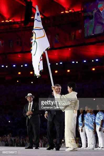 Mayor of Rio de Janeiro Eduardo Paes IOC President Thomas Bach and Governor of Tokyo Yuriko Koike stand on stage for the Flag Handover Ceremony...