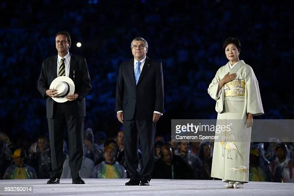Mayor of Rio de Janeiro Eduardo Paes IOC President Thomas Bach and Governor of Tokyo Yuriko Koike take part in the Flag Handover Ceremony during the...