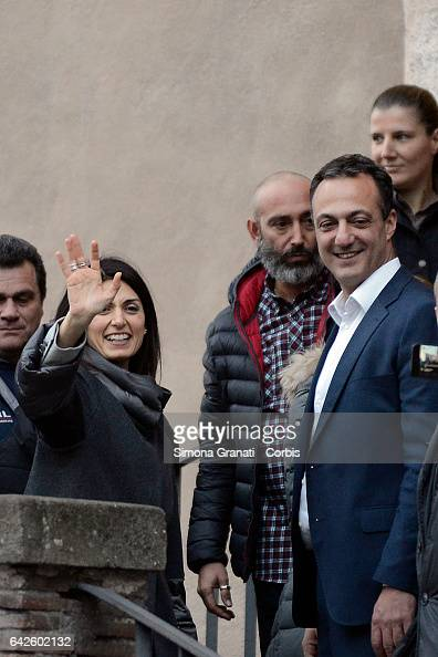 Mayor of Rome Virginia Raggi accompanied by Marcello De Vito greets supporters who had gathered at the Capitol to show their support for her and her...