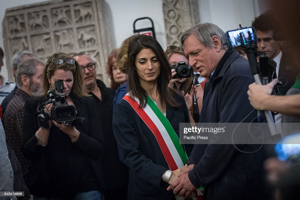 Mayor of Rome Virginia Raggi (L) and Don Luigi Ciotti (R) during the funeral of Director Giuseppe Ferrara in Rome. Burning chamber on Capitol Hill for the director Giuseppe Ferrara, to take part in the Sala del Carroccio, also joined were the mayor of Rome Virginia Raggi, the director Giuseppe Tornatore and Don Luigi Ciotti of Libera.