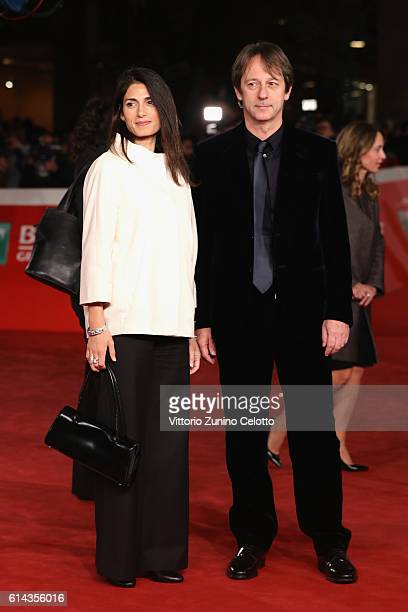 Mayor of Rome Virginia Raggi and Luca Bergamo walk a red carpet for 'Moonlight' on October 13 2016 in Rome Italy