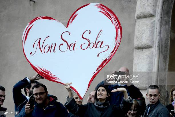 Mayor of Rome Virginia Raggi greets supporters at the Capitol offering her support and holds a big heart in her hand given to her by the protesters...