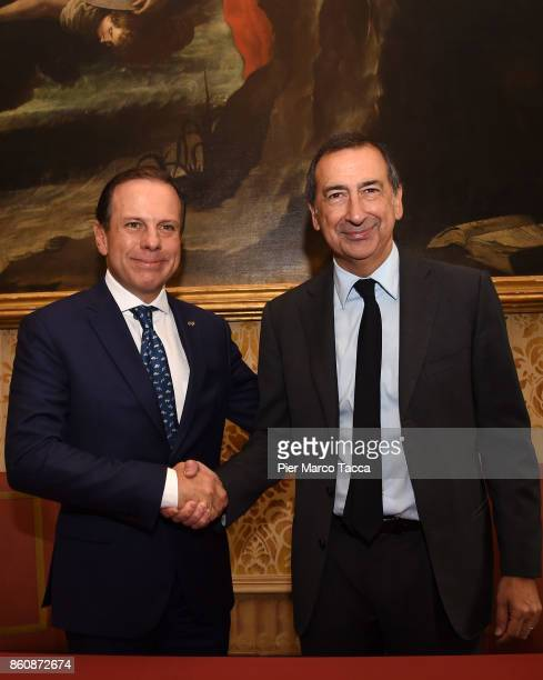 Mayor of Sao Paulo Joao Doria shakes hands at the Mayor of Milan Giuseppe Sala during the press conference at Palazzo Marino on October 13 2017 in...