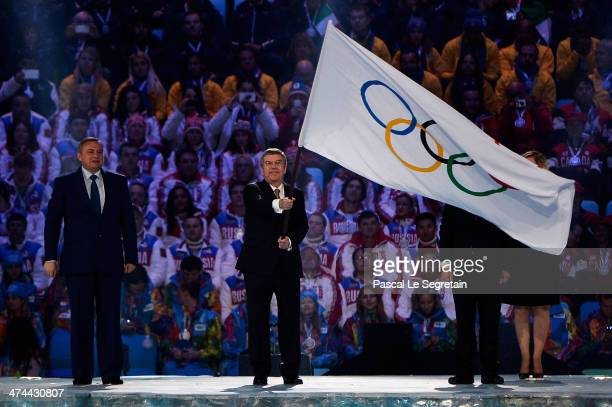 Mayor of Sochi Anatoly Pakhomov and Mayor of Pyeongchang Lee Seokrae look on as President of the International Olympic Committee Thomas Bach waves...
