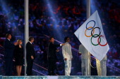 Mayor of Sochi Anatoly Pakhomov and President of the International Olympic Committee Thomas Bach look on as Mayor of Pyeongchang Lee Seokrae waves...