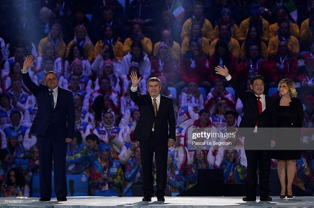 Mayor of Sochi Anatoly Pakhomov, President of the International Olympic Committee (IOC) Thomas Bach and Mayor of Pyeongchang Lee Seok-rae wave during the 2014 Sochi Winter Olympics Closing Ceremony at Fisht Olympic Stadium on February 23, 2014 in Sochi, Russia.