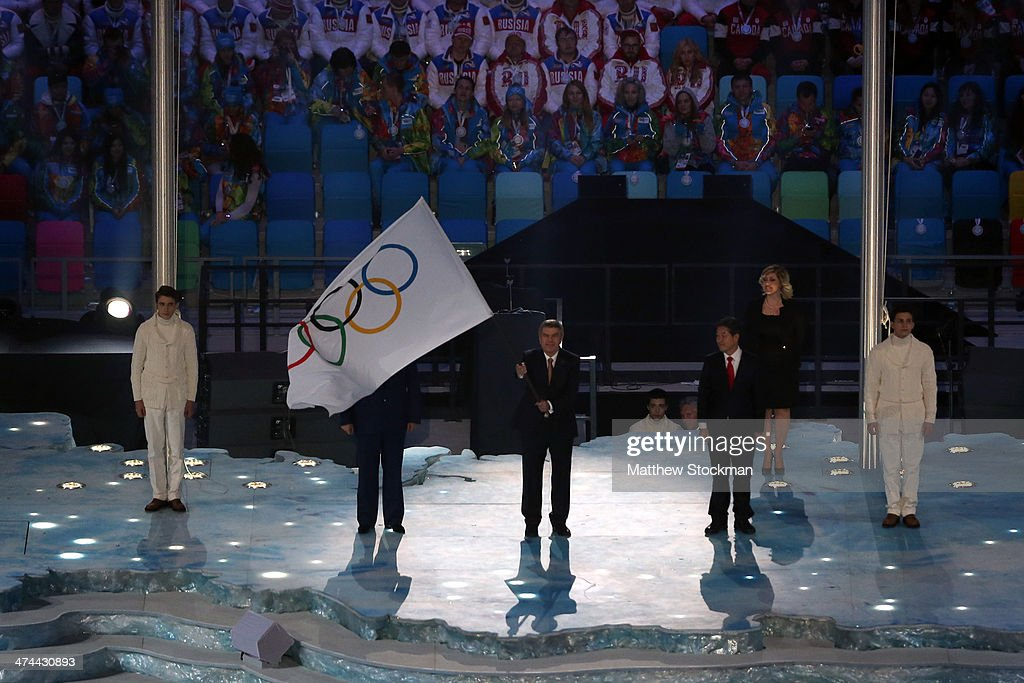 Mayor of Sochi Anatoly Pakhomov, President of the International Olympic Committee (IOC) Thomas Bach and Mayor of Pyeongchang Lee Seok-rae during the flag handover ceremony as part of the 2014 Sochi Winter Olympics Closing Ceremony at Fisht Olympic Stadium on February 23, 2014 in Sochi, Russia.