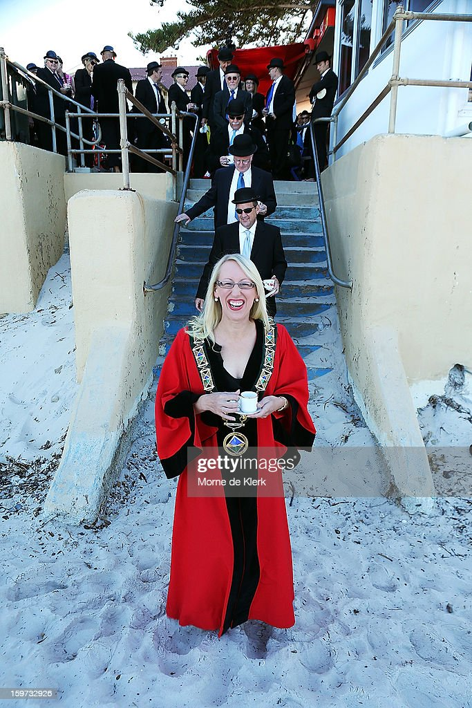 Mayor of the City of Charles Sturt Kirsten Alexander walks onto the beach to take part in an art installation created by surrealist artist Andrew Baines on January 20, 2013 in Adelaide, Australia.