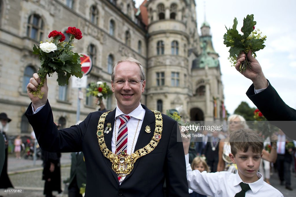 Mayor of the city of Hanover Stefan Schostok waves to the crowd during a parade at the world's largest shooting fair, known as Schutzenfest, on July 6, 2014 in Hanover, Germany. A Schutzenfest, or German 'Marksmen's Festival' is a traditional festival featuring a target shooting competition in the cultures of both Germany and Switzerland. Reports indicate that more than a million visitors are expected to attend the 2014 Marksmen's Festival.