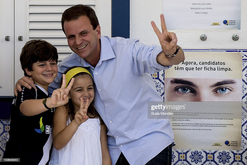Mayor of the city of Rio de Janeiro and candidate for reelection, <a gi-track='captionPersonalityLinkClicked' href=/galleries/search?phrase=Eduardo+Paes&family=editorial&specificpeople=5692531 ng-click='$event.stopPropagation()'>Eduardo Paes</a> votes accompanied by his sons and nephews in Gavea Golf Club on October 07, 2012 in Rio de Janeiro, Brazil.