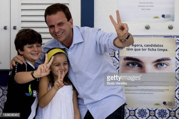 Mayor of the city of Rio de Janeiro and candidate for reelection Eduardo Paes votes accompanied by his sons and nephews in Gavea Golf Club on October...