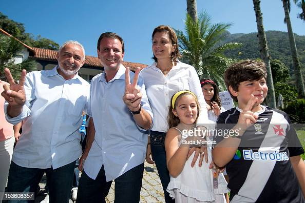 Mayor of the city of Rio de Janeiro and candidate for reelection Eduardo Paes poses for a picture with his family and the Vice Mayor Adilson Pires...