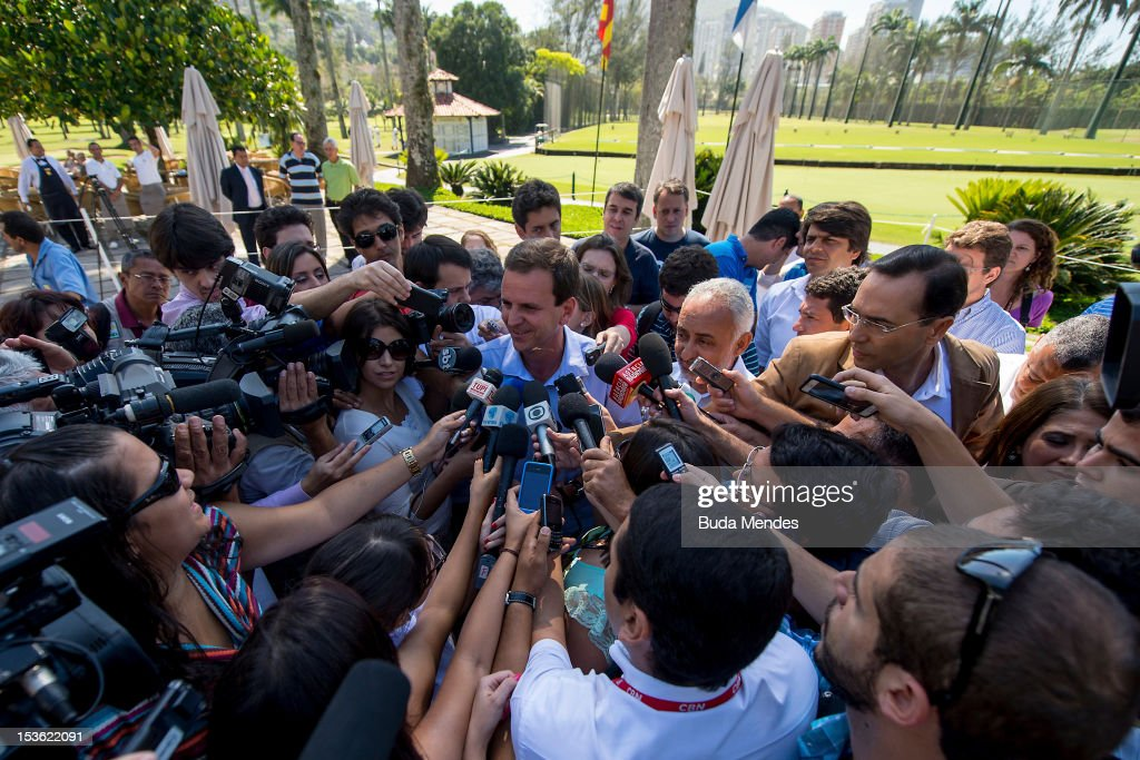 Mayor of the city of Rio de Janeiro and candidate for reelection Eduardo Paes talks to the press after voting in Gavea Golf Club on October 07 2012...