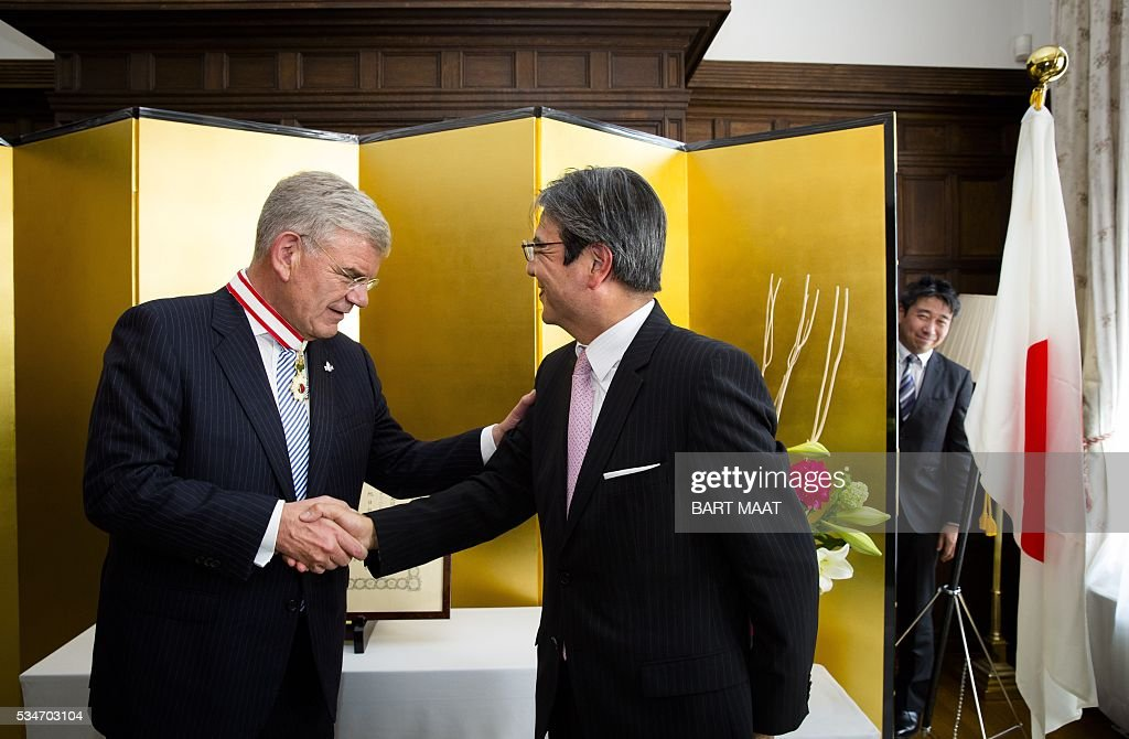Mayor of Utrecht Jan van Zanen receives imperial award from the Japanese Ambassador, Hiroshi Inomata, in The Hague, on May 27, 2016. / AFP / ANP / Bart Maat / Netherlands OUT