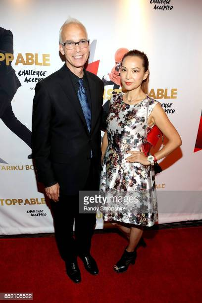Mayor of West Hollywood John Heilman and Lily Lisa attend 'Unstoppable' Tariku Bogale book launch on September 22 2017 in West Hollywood California