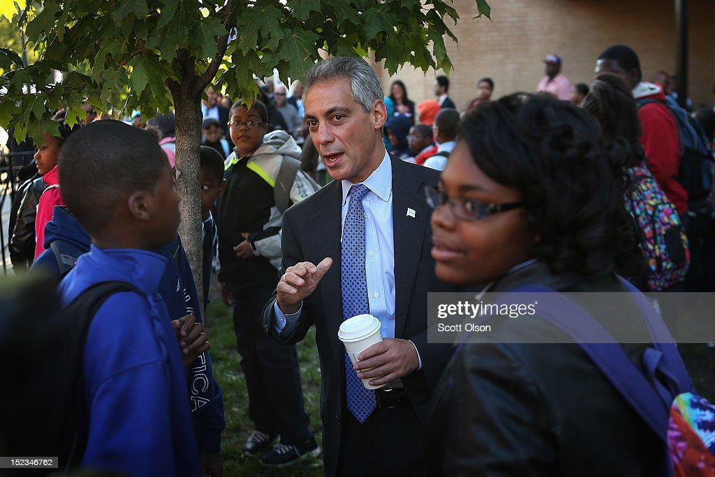 Mayor Rahm Emanuel greets students as they arrive for school at Frazier International Magnet School on September 19, 2012 in Chicago, Illinois. Today was the first day back at school for about 350,000 Chicago public school children after more than 26,000 teachers and support staff walked off of their jobs on September 10 after the Chicago Teachers Union failed to reach an agreement with the city on compensation, benefits and job security.