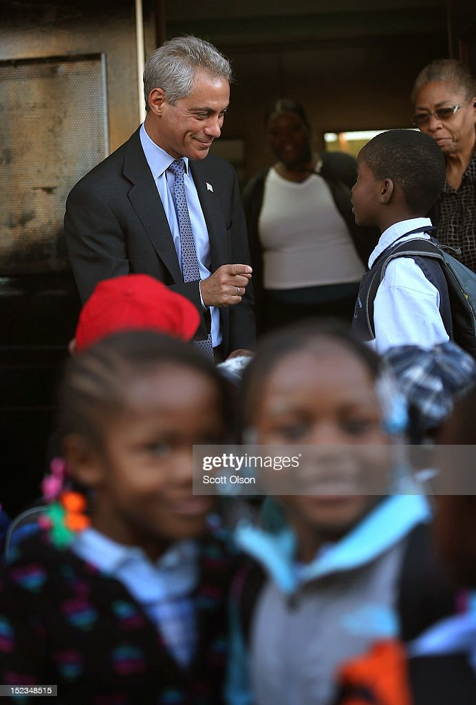 Mayor <a gi-track='captionPersonalityLinkClicked' href=/galleries/search?phrase=Rahm+Emanuel&family=editorial&specificpeople=753774 ng-click='$event.stopPropagation()'>Rahm Emanuel</a> greets students as they arrive for school at Frazier International Magnet School on September 19, 2012 in Chicago, Illinois. Today was the first day back at school for about 350,000 Chicago public school children after more than 26,000 teachers and support staff walked off of their jobs on September 10 after the Chicago Teachers Union failed to reach an agreement with the city on compensation, benefits and job security.