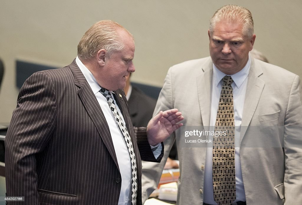 Mayor Rob Ford and his brother <a gi-track='captionPersonalityLinkClicked' href=/galleries/search?phrase=Doug+Ford+-+Politician&family=editorial&specificpeople=10957178 ng-click='$event.stopPropagation()'>Doug Ford</a> were on hand inside council chambers Monday morning. Toronto City Hall saw a boost of colour on Monday after a group of councillors wore pink to celebrate their last council session before the election and to protest against Rob Fords performance as mayor. August 25, 2014.