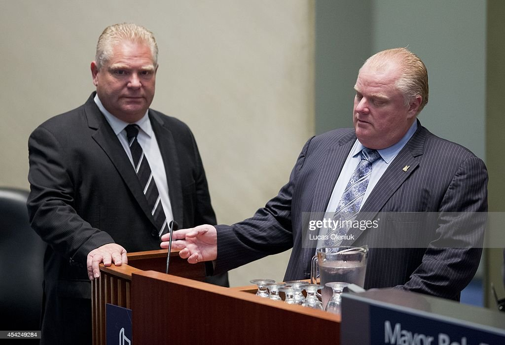 Mayor Rob Ford chatted with his brother <a gi-track='captionPersonalityLinkClicked' href=/galleries/search?phrase=Doug+Ford+-+Politician&family=editorial&specificpeople=10957178 ng-click='$event.stopPropagation()'>Doug Ford</a> Tuesday morning at city hall. Toronto city council is meeting this week for the last time before the upcoming municipal election. Aug 26, 2014