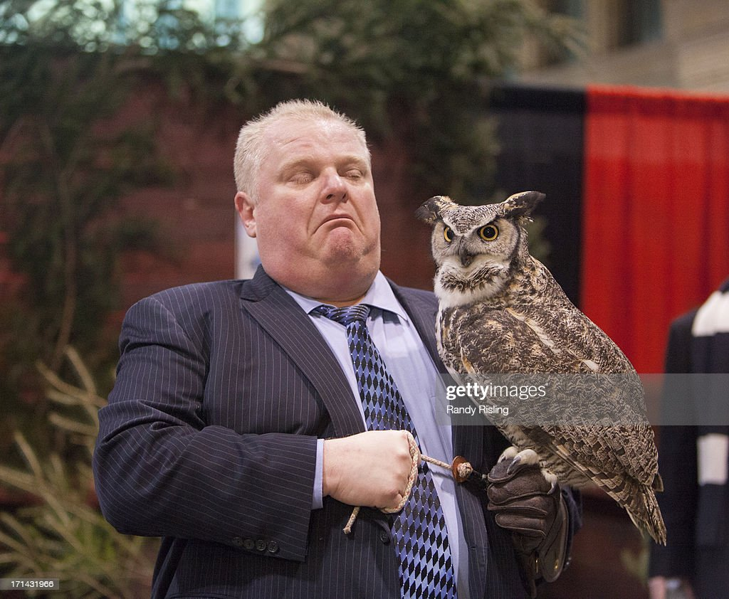 Mayor Rob Ford holds a North American Great Horned Owl at the Toronto Sportsmen's Show at the Direct Energy Centre, Exhibition Place. Feb. 7, 2013. RANDY