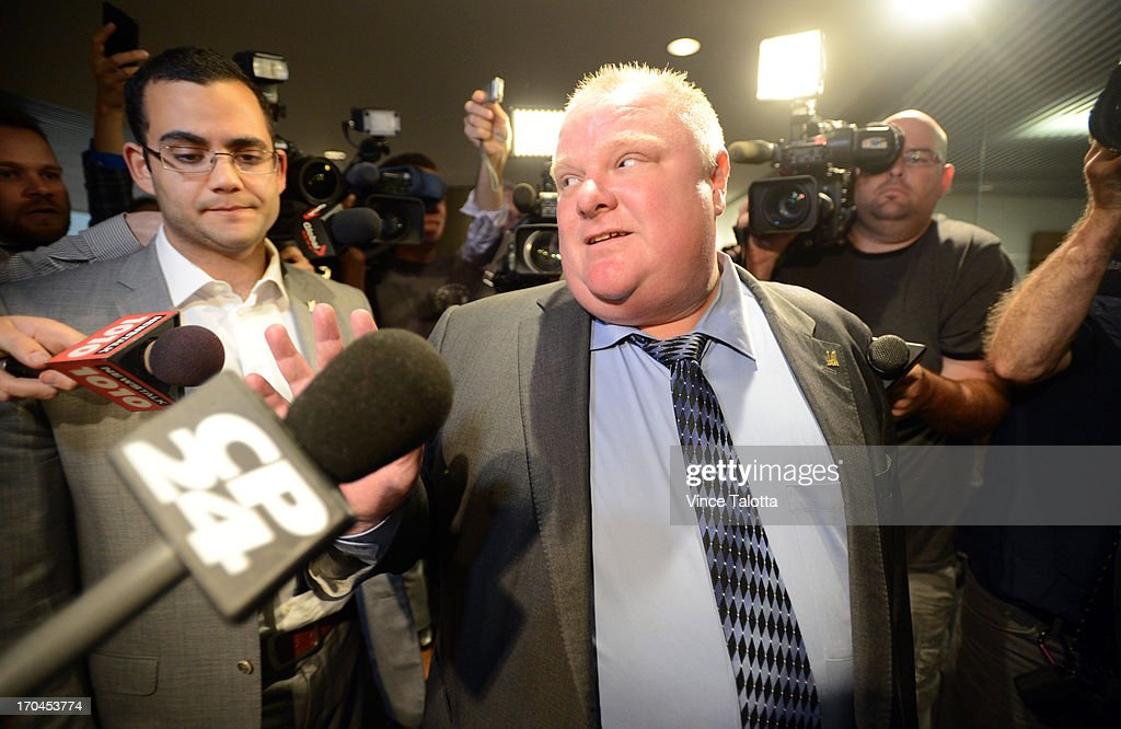 Mayor Rob Ford is surrounded by media as arrives at his office after the lunch hour at City Hall. Earlier in the day Toronto Police launched a massive predawn raid, as part of Project Traveller, targeting guns and drugs, and focusing on the Toronto neighbourhood thats ground zero for the Mayor Rob Ford crack video scandal.