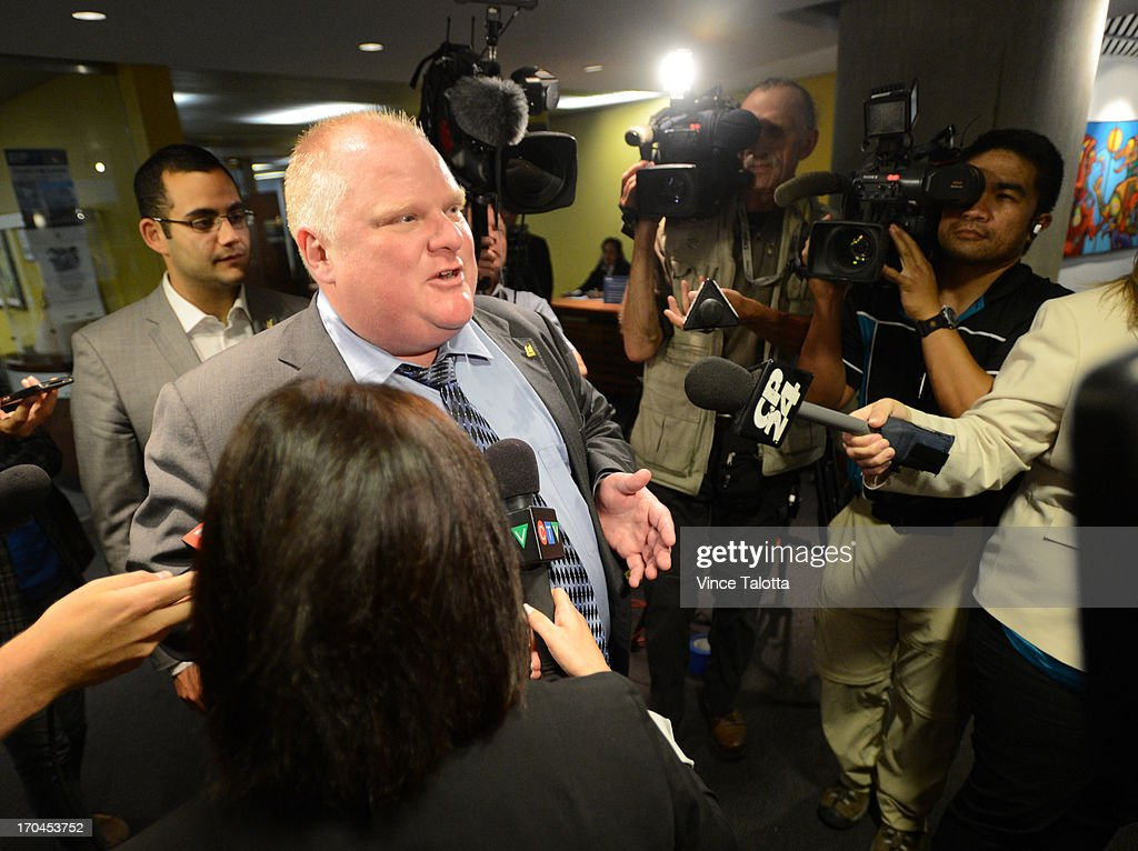 Mayor Rob Ford is surrounded by media as he leaves his office after the lunch hour at City Hall. Earlier in the day Toronto Police launched a massive predawn raid, as part of Project Traveller, targeting guns and drugs, and focusing on the Toronto neighbourhood thats ground zero for the Mayor Rob Ford crack video scandal.