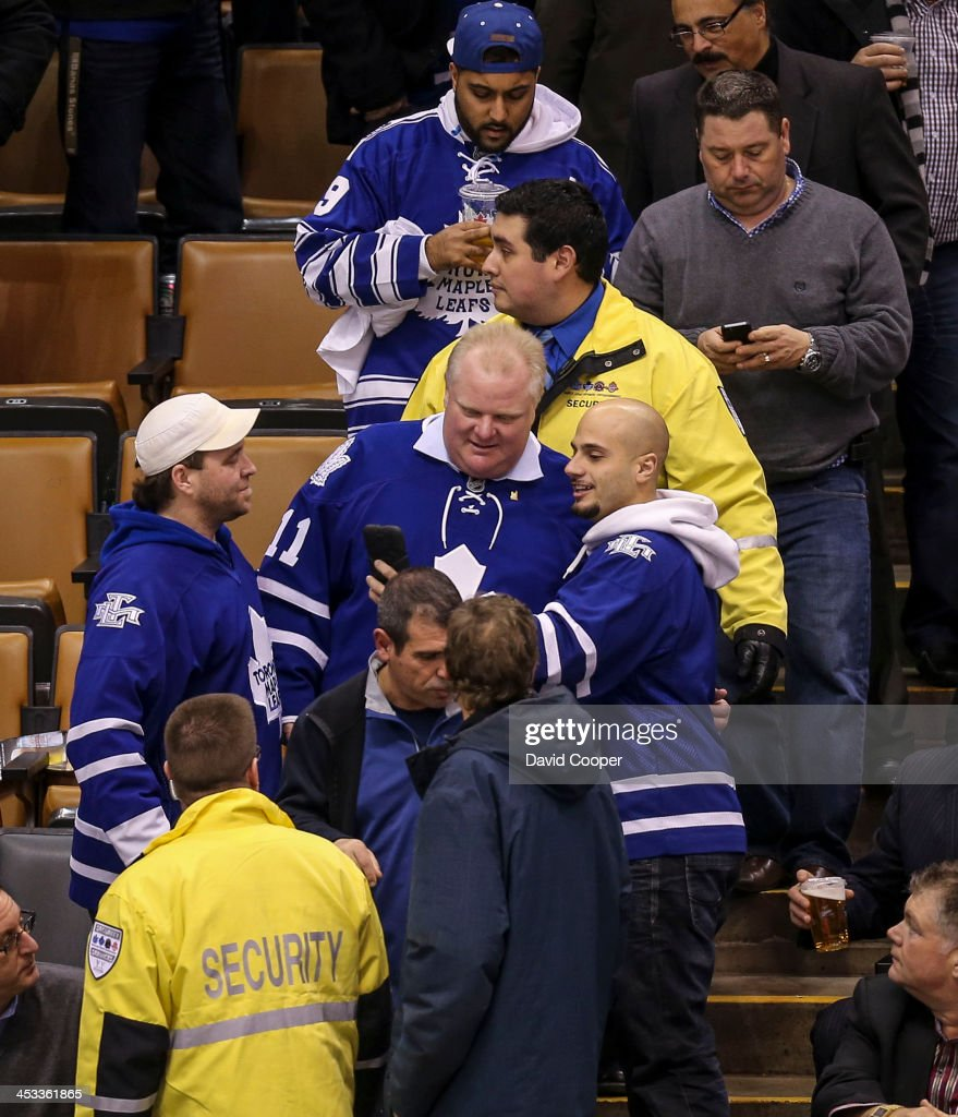 TORONTO, ON- DECEMBER 3 - Mayor Rob Ford leaves his seat behind the San Jose Sharks bench with a few minutes to go in the 3rd period as the Toronto Maple Leafs take on the San Jose Sharks at the Air Canada Centre in Toronto December 3, 2013.