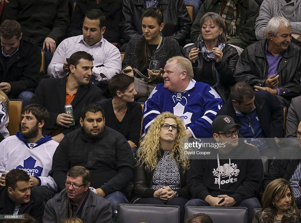 TORONTO, ON- DECEMBER 3 - Mayor Rob Ford sitting in the seats behind the San Jose Sharks bench talking with fans durint the 3rd period as the Toronto Maple Leafs take on the San Jose Sharks at the Air Canada Centre in Toronto December 3, 2013.