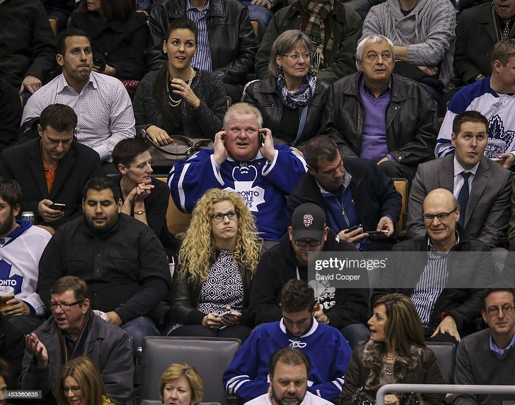 TORONTO, ON- DECEMBER 3 - Mayor Rob Ford talks on his cell phone as he sitting in the seats behind the San Jose Sharks bench the 3rd period as the Toronto Maple Leafs take on the San Jose Sharks at the Air Canada Centre in Toronto December 3, 2013.