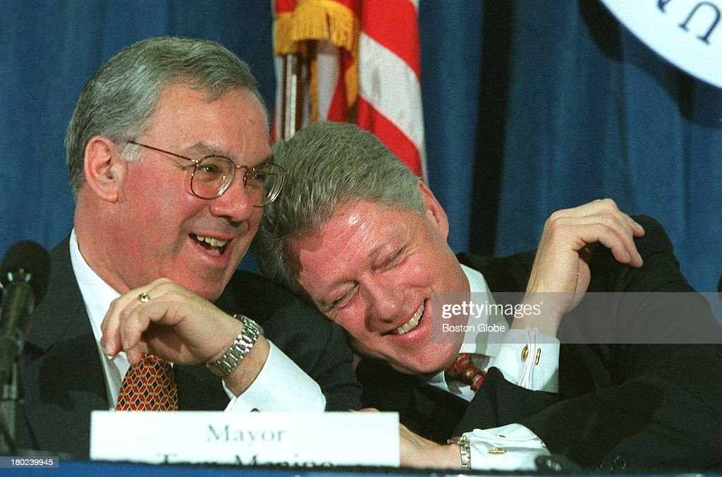 Mayor Thomas M. Menino and President Bill Clinton share a laugh regarding 'gaining and losing weight' during a roundtable discussion at UMass Boston on Wednesday. Ralph Martin made the analogy of gaining and losing weight, when Gov. Weld told the president he wasn't referring to the president. Clinton was in town to support Mayor Menino's efforts on fighting juvenile crime.
