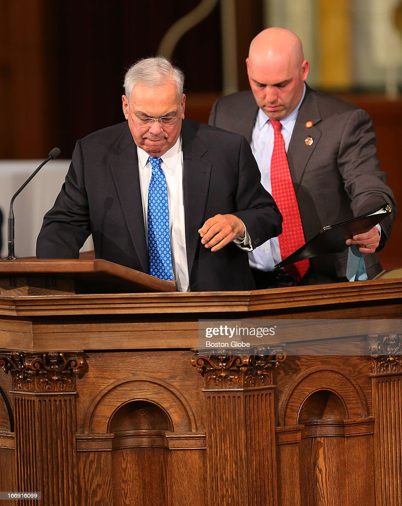Mayor Thomas Menino gets up from his wheelchair to speak at the pulpit during an interfaith healing service for the victims of the Boston Marathon bombing. He recently suffered a broken leg.
