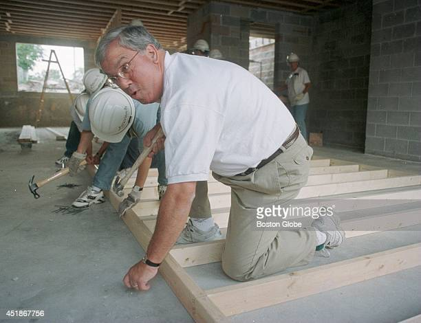 Mayor Tom Menino pounds a nail into a 2x4 at the Habitat for Humanity house building project at Warren Blvd in West Chicago 3 blocks from the United...