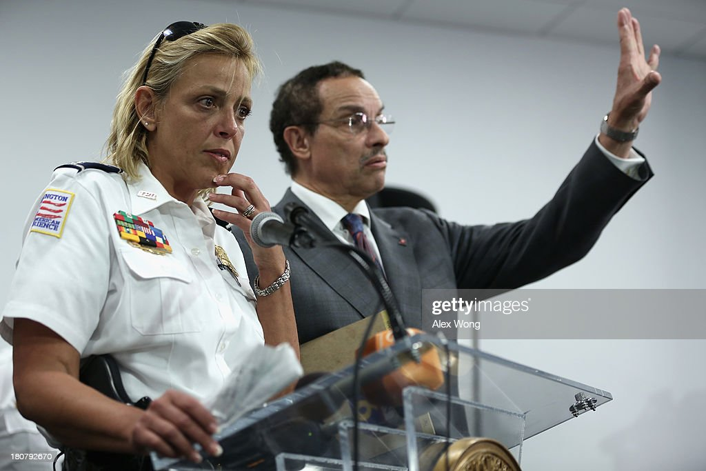 DC Mayor Vincent Gray (R) and DC Police Chief Cathy Lanier (L) brief members of the media at a DC government building not far away from the Washington Navy Yard on September 16, 2013 in Washington, DC. At least twelve people were shot dead as a result of a shooting rampage at the Washington Navy Yard and one alleged gunman was killed in an incident that put parts of the city on lockdown.