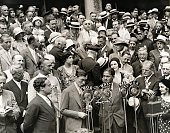 Mayor Walker introducing to the radio audience Bobby Jones the great golfer who was given a great welcome reception by the city of New York Behind...