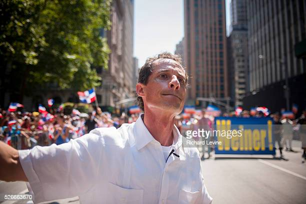 NYC Mayoral candidate and disgraced congressman Anthony Weiner joins thousands of DominicanAmericans and their friends and supporters as he campaigns...