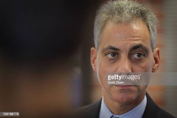 Mayoral candidate and former White House Chief of Staff Rahm Emanuel listens to a presentation during a campaign stop at a proposed Brownfield...