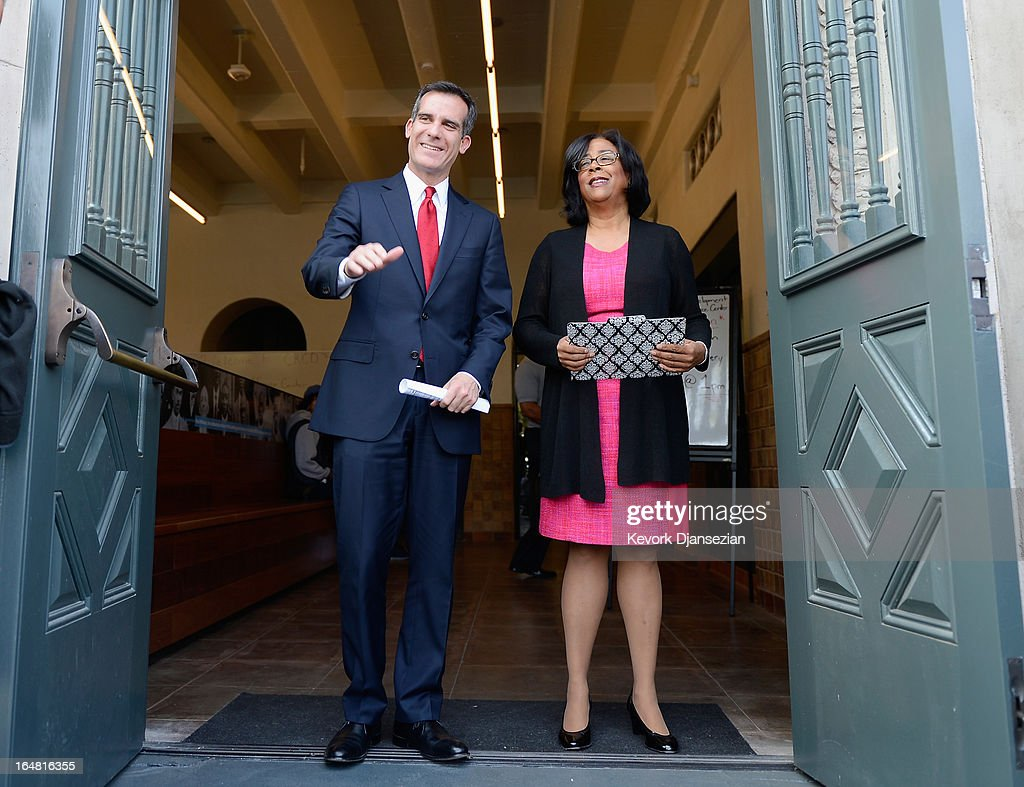 Mayoral candidate Councilman <a gi-track='captionPersonalityLinkClicked' href=/galleries/search?phrase=Eric+Garcetti&family=editorial&specificpeople=635706 ng-click='$event.stopPropagation()'>Eric Garcetti</a> (L) and one-time mayoral candidate Councilwoman Jan Perry arrive to announce Perry's endorsement of Garcetti in the Los Angeles mayoral race, on the front steps of the YMCA on March 28, 2013 in Los Angeles, California. Garcetti is in a tight race for the May 21 runoff against second-place finisher City Controller Wendy Greuel.