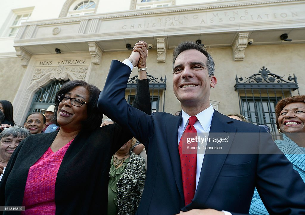 Mayoral candidate Councilman <a gi-track='captionPersonalityLinkClicked' href=/galleries/search?phrase=Eric+Garcetti&family=editorial&specificpeople=635706 ng-click='$event.stopPropagation()'>Eric Garcetti</a> (R) holds up the arm of one-time mayoral candidate Councilwoman Jan Perry after she threw her support behind him in the Los Angeles mayoral race, on the front steps of the YMCA on March 28, 2013 in Los Angeles, California. Garcetti is in a tight race for the May 21 runoff against second-place finisher City Controller Wendy Greuel.