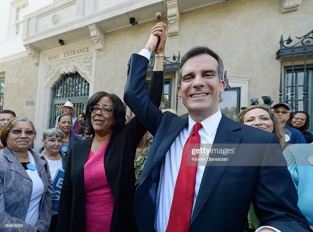 Mayoral candidate Councilman Eric Garcetti (R) holds up the arm of one-time mayoral candidate Councilwoman Jan Perry after she threw her support behind him in the Los Angeles mayoral race, on the front steps of the YMCA on March 28, 2013 in Los Angeles, California. Garcetti is in a tight race for the May 21 runoff against second-place finisher City Controller Wendy Greuel.