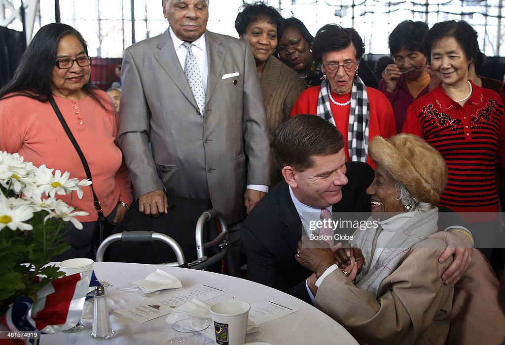 Mayor-elect Marty Walsh leans down to give Josephine Worrell, 101, of Boston a hug at a brunch for seniors at Northeastern University's Cabot Athletic Center in Boston, Jan. 5, 2014.