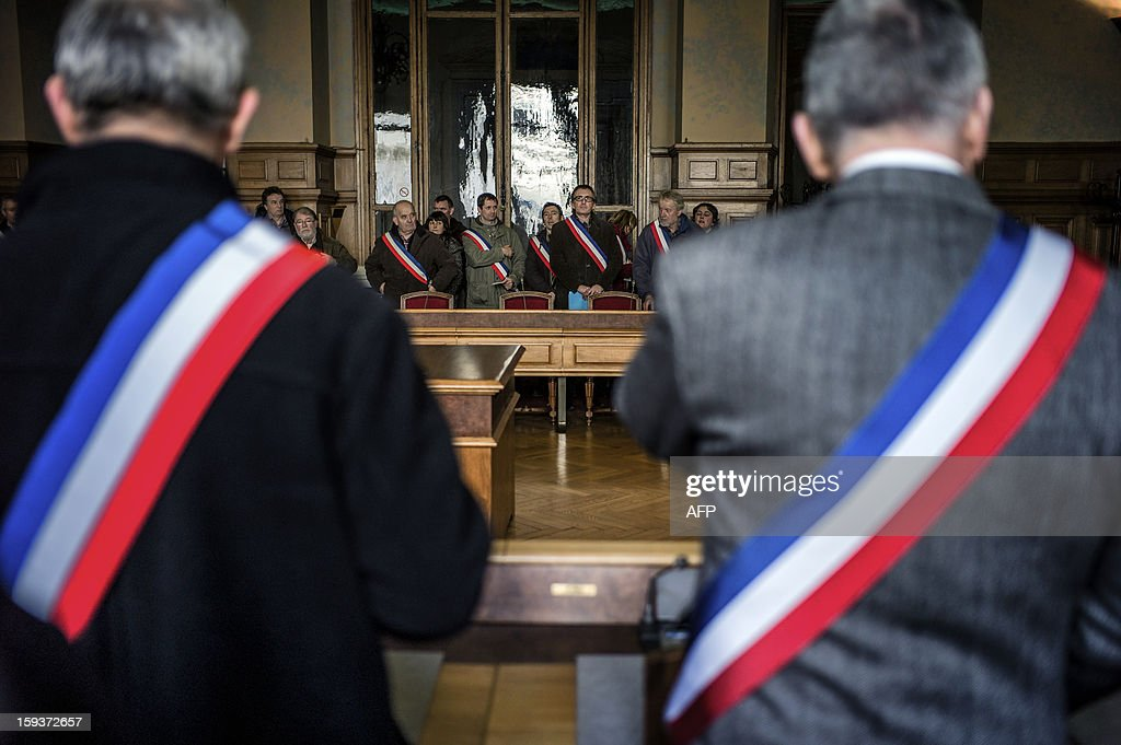Mayors and deputies gather in the Loire prefecture on January 12, 2013 in Saint-Etienne, to present their resignation in protest against the merging of their towns into the Roanne's agglomeration.