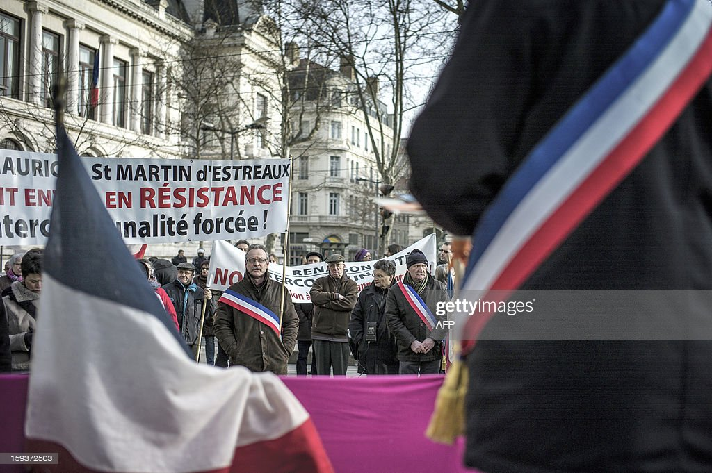 Mayors and deputies gather on January 12, 2013 in Saint-Etienne, to present their resignation in protest against the merging of their towns into the Roanne's agglomeration.