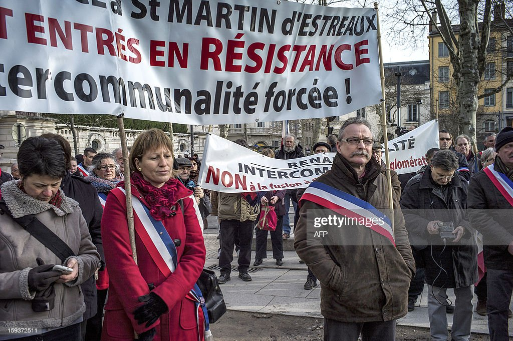 Mayors and deputies gather on January 12, 2013 in Saint-Etienne, to present their resignation in protest against the merging of their towns into the Roanne's agglomeration. AFP PHOTO / JEFF PACHOUD