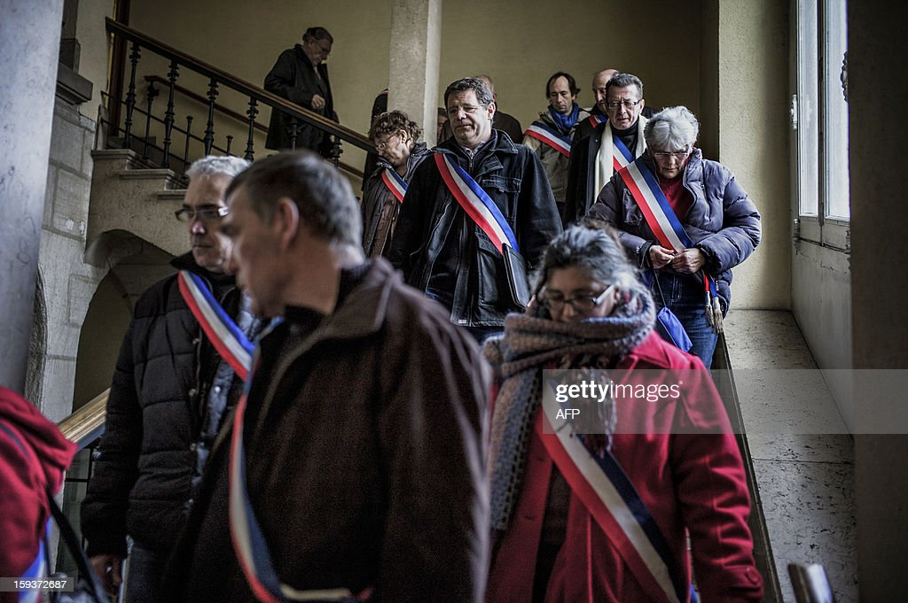 Mayors and deputies leave the Loire prefecture on January 12, 2013 in Saint-Etienne, after presenting their resignation in protest against the merging of their towns into the Roanne's agglomeration.