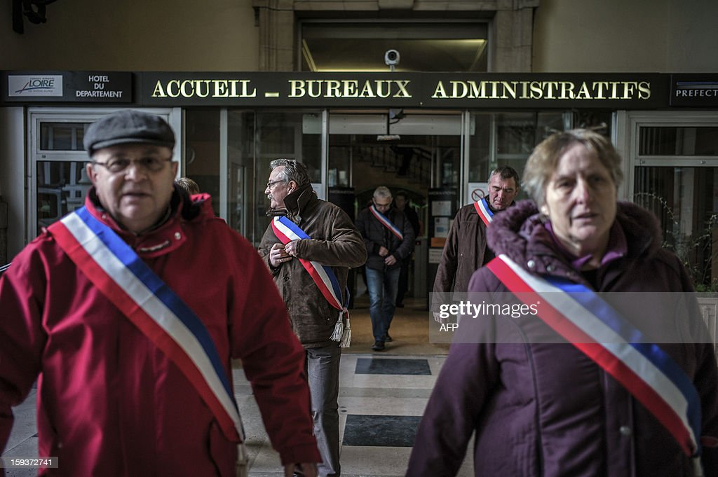 Mayors and deputies leave the Loire prefecture on January 12, 2013 in Saint-Etienne, to present their resignation in protest against the merging of their towns into the Roanne's agglomeration. AFP PHOTO / JEFF PACHOUD