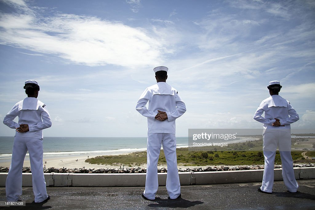 Mayport, Florida, August 4, 2012 - Sailors man the rails as the ship pulls into Naval Station Norfolk.