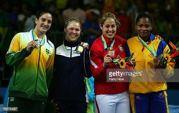 Mayra Silva of Brazil Ronda Rousey of the United States of America Catherine Roberge Yuri Alver Colombia pose with medals after the Women's 70Kg Judo...