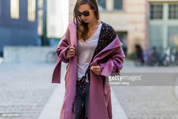 Mayrlou Becker wearing a pink coat with bows Converse chucks ripped denim jeans fishnet tights sunglasses on March 24 2017 in Berlin Germany
